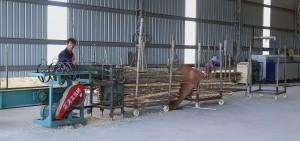1.Splitting raw bamboo tubes into strips